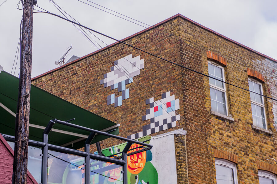 Invader - 10x street artists from London you don't want to miss || The Travel Tester