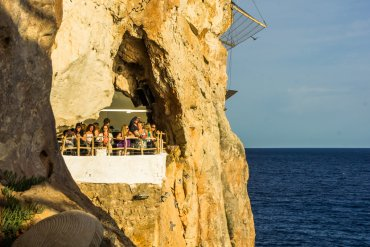 Drinks in a Cave at Cova D'En Xoroi in Menorca, Spain