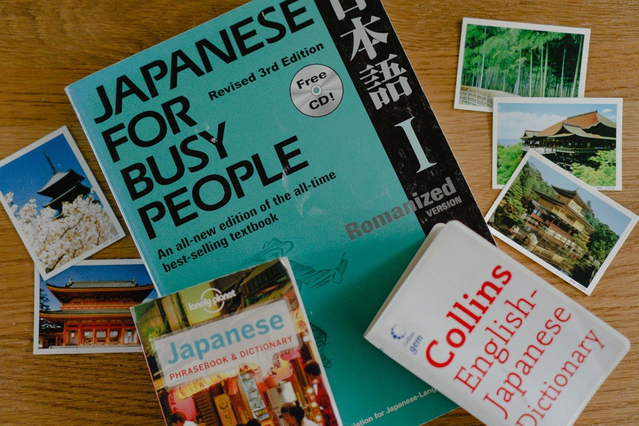 """Book """"Japanese for Busy People"""" and Japanese Dictionary on table"""